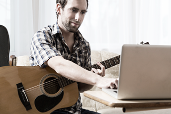 guitarist composing music with finale software