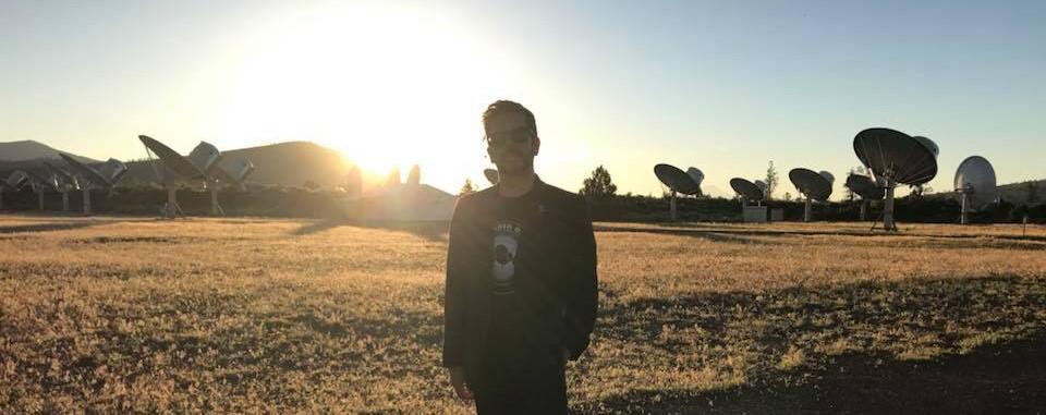 Image of Felipe Perez Santiago in front of the Allen Telescope Array